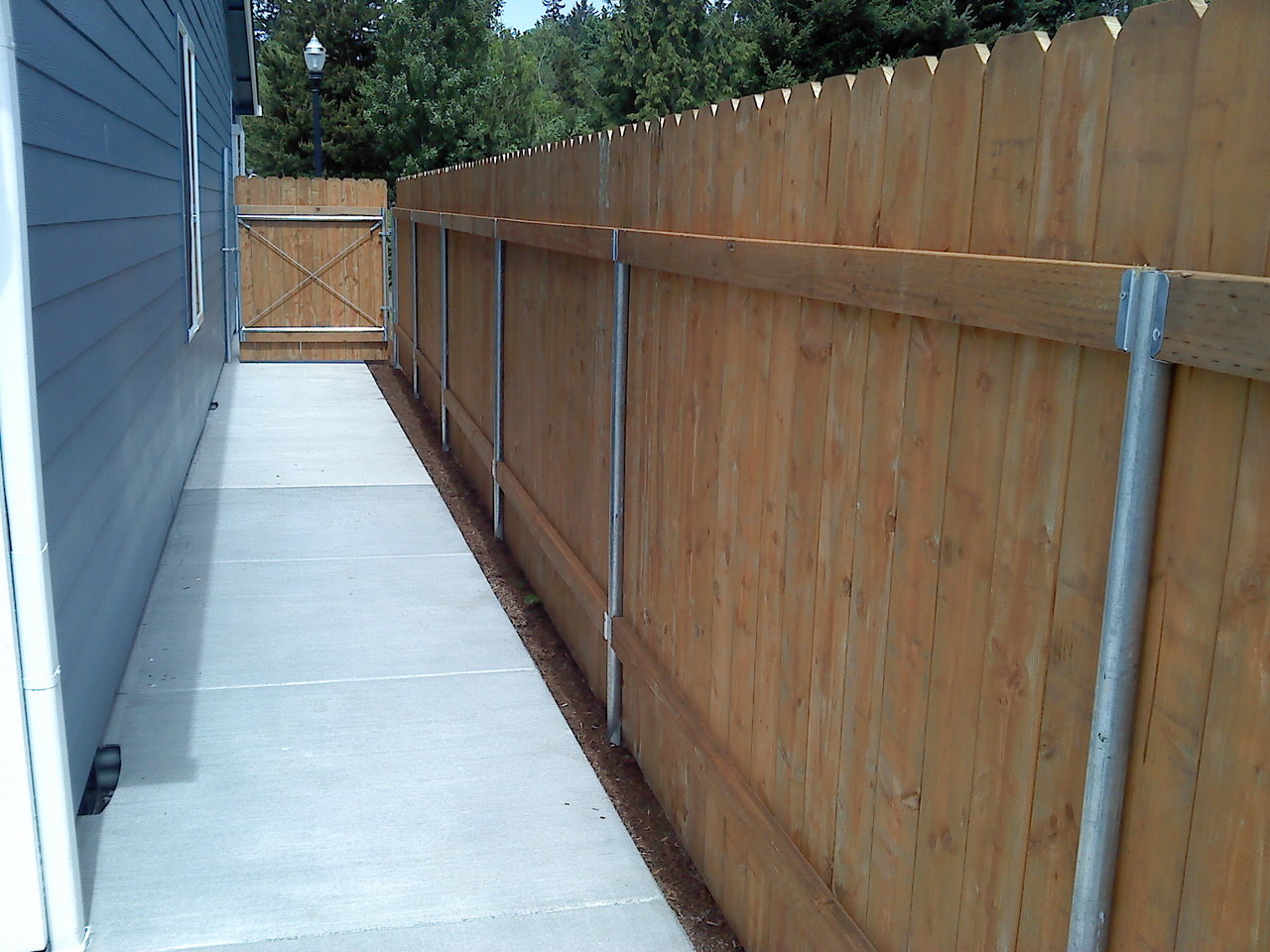 Picture of: Building A Treated Wood Fence