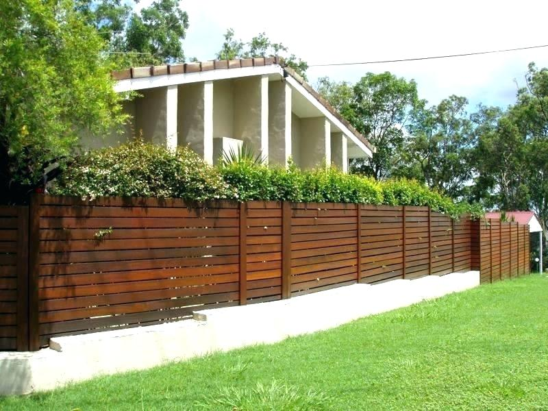 Picture of: Corner Backyard Fence Ideas