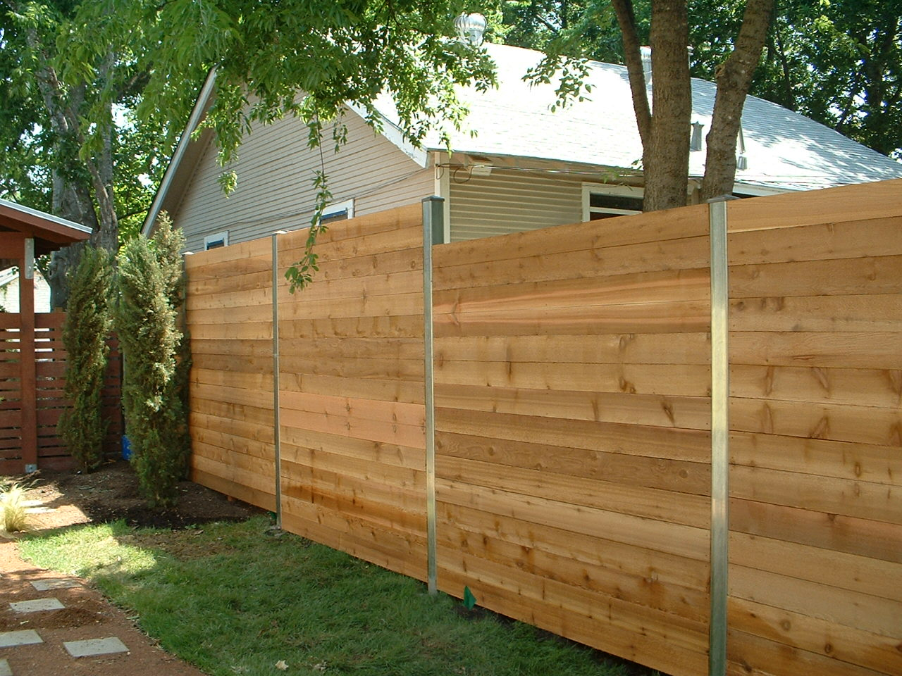 Picture of: Metal Fence Posts for Wood Fence Photo