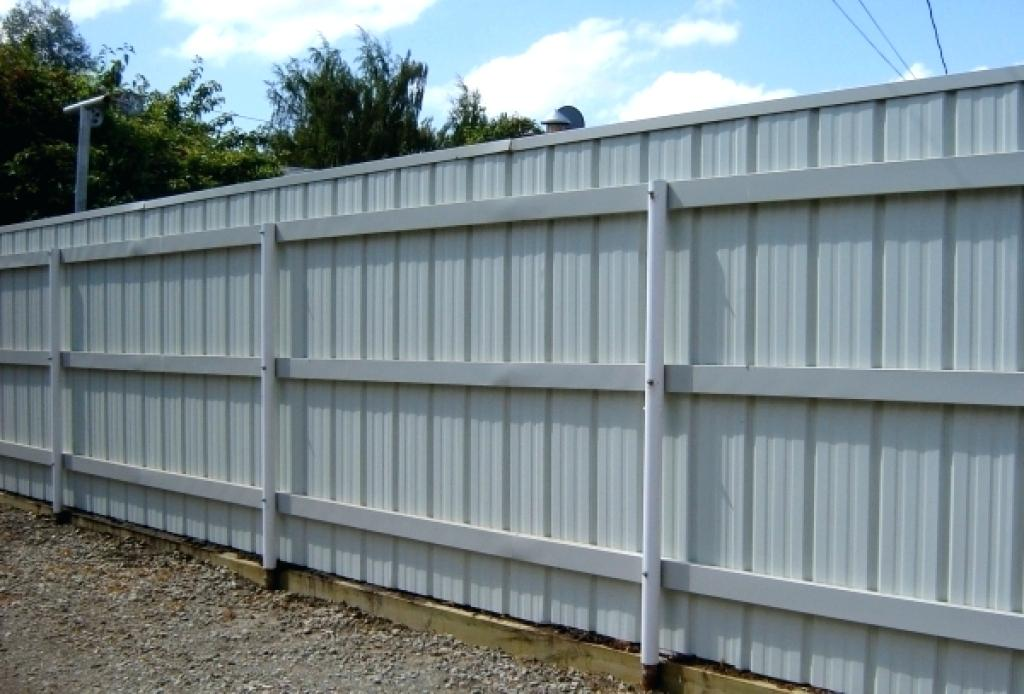 Metal Fence Panels On A Retaining Wall