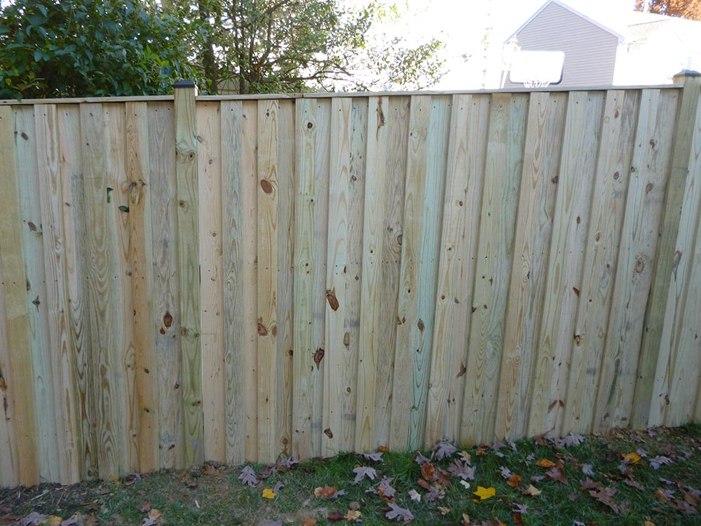 Picture of: Treated Wood Fence Maintenance