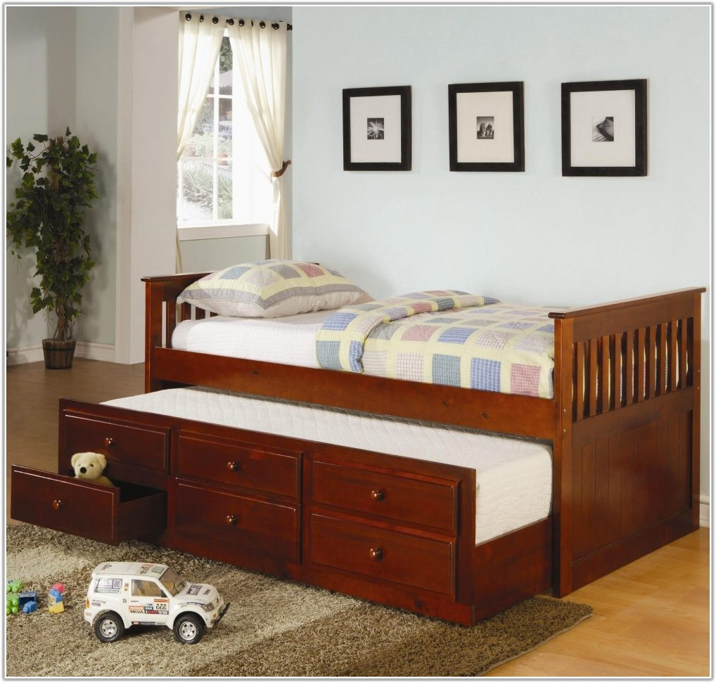 Image of: Twin Trundle Bed with Storage Beside Window