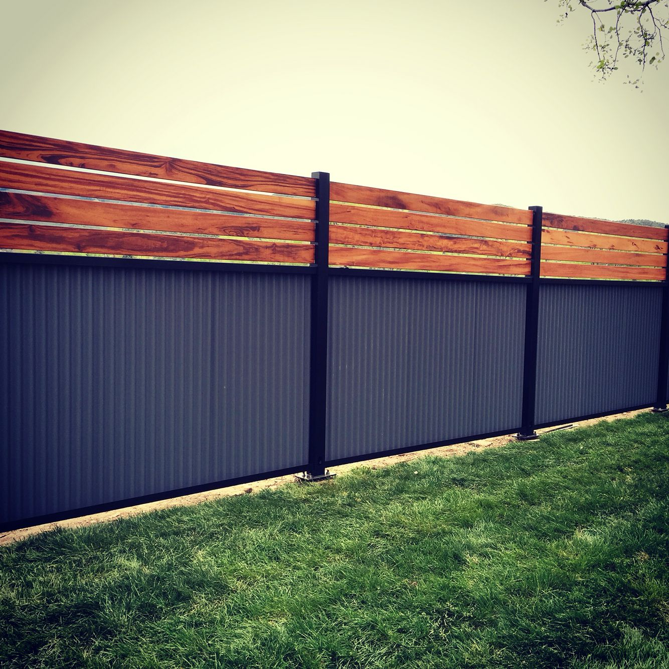 Picture of: Wood and Metal Fence Black