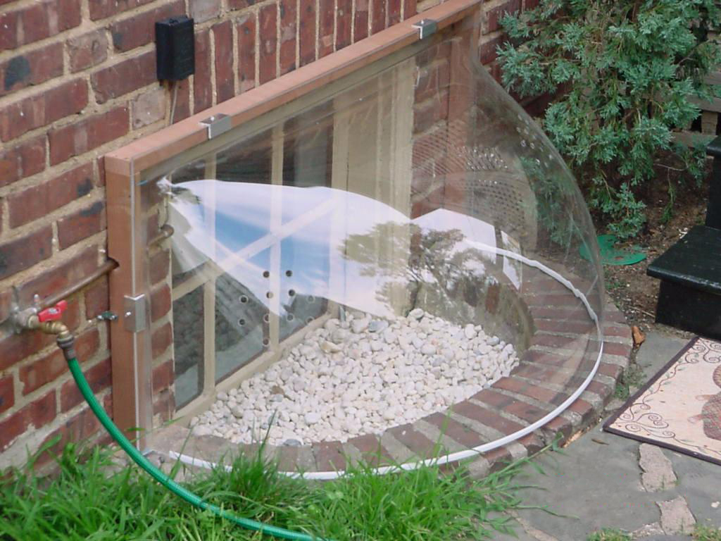 Picture of: Basement Window Well Covers Bubble
