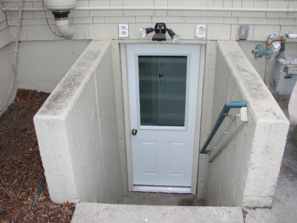 Image of: Exterior Basement Doors Bind on Frame in the winter