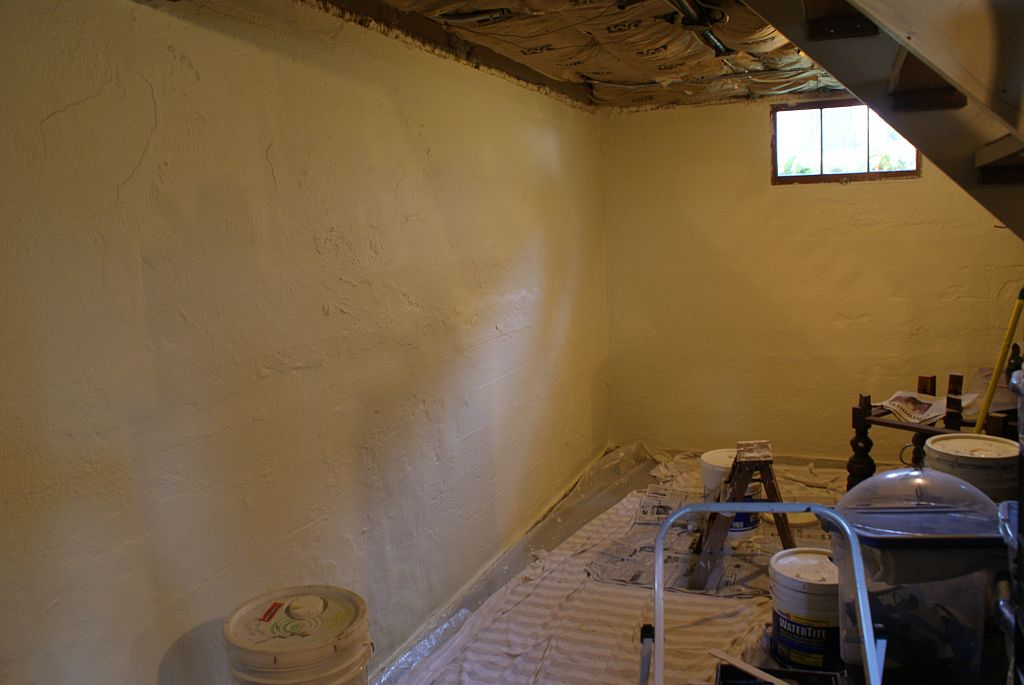 Picture of: Painting Unfinished Basement Walls Dark